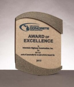2013 Award of Excellence from the Michigan Concrete Association for Cannonsville Rd to M-46 in Howards City, MI