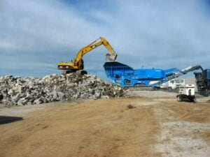 Concrete crushing and recycling of demolished runway to create class 6 road base