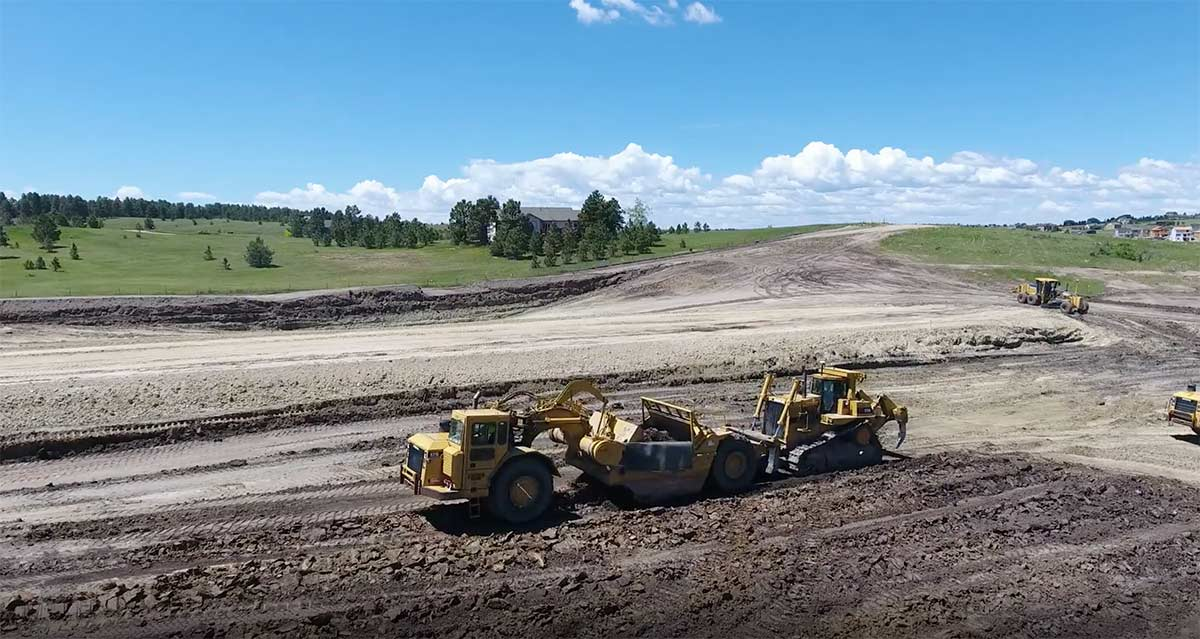 Gold Creek Valley Land Development Earthwork with Scrapers moving millions of tons of earth